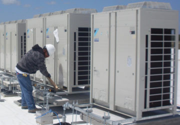 HVAC Technician working on rooftop units